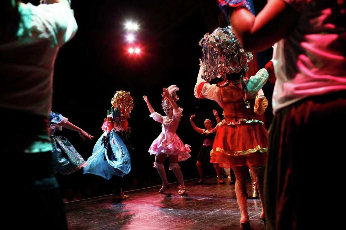 """King Anchovy XLVI Tim Champion (left) and Joslyn Campbell, the choreographer (right), dance during the The Order of the A-Corn """"Arrival of King Anchovy XLVI,"""" Ruler and Sovereign Head of Cornyation 2011, during Cornyation, The Court of Double-Dip Shellacking, at the Charline McCombs Empire Theatre on Tuesday, April 12, 2011."""