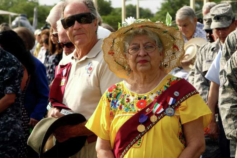 Margarita Fresquez-Zaske watches the annual Fiesta parade at Lackland AFB on Wednesday, April 13, 20