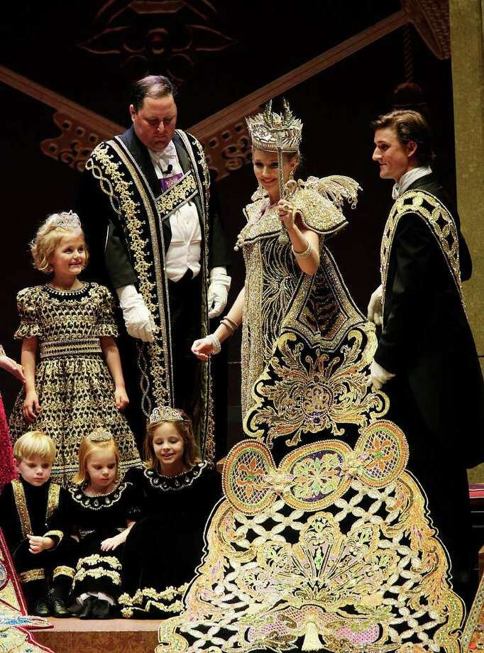 Sallie W. Lewis, 23, Order of the Alamo's Queen of the Court of Timeless Treasures, waves to the crowd during her coronation at the Municipal Auditorium on Wednesday, April 13, 2011. Photo: JERRY LARA, Jerry Lara/Express-News / SAN ANTONIO EXPRESS-NEWS