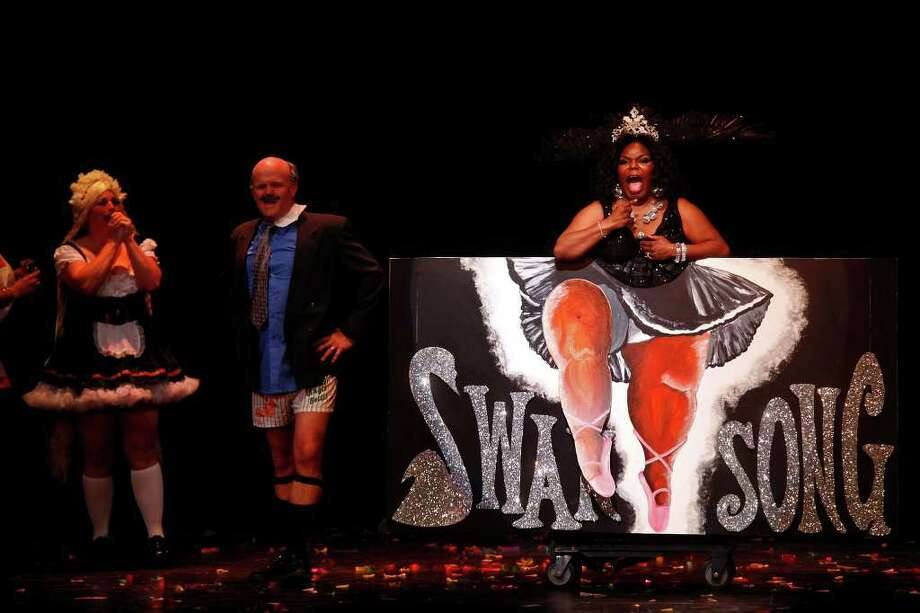 "Kitty Williams, right, plays Oprah Winfrey, with Sheila Sisler-Currie, left, as Olga Winfrey, and David Currie as Dr. Phil, as they perform ""The Duchess of Eternal Entrepreneurial Enterprises"" representing Oprah's Black Swan Song, during Cornyation, The Court of Double-Dip Shellacking, at the Charline McCombs Empire Theatre on Tuesday, April 12, 2011. Photo: LISA KRANTZ, Lisa Krantz/Express-News / SAN ANTONIO EXPRESS-NEWS"