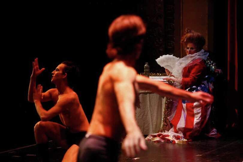 MC Dana Montana, right, watches as Shay Bares, left, and Carlos Hopuy, center, with Ballet San Anton