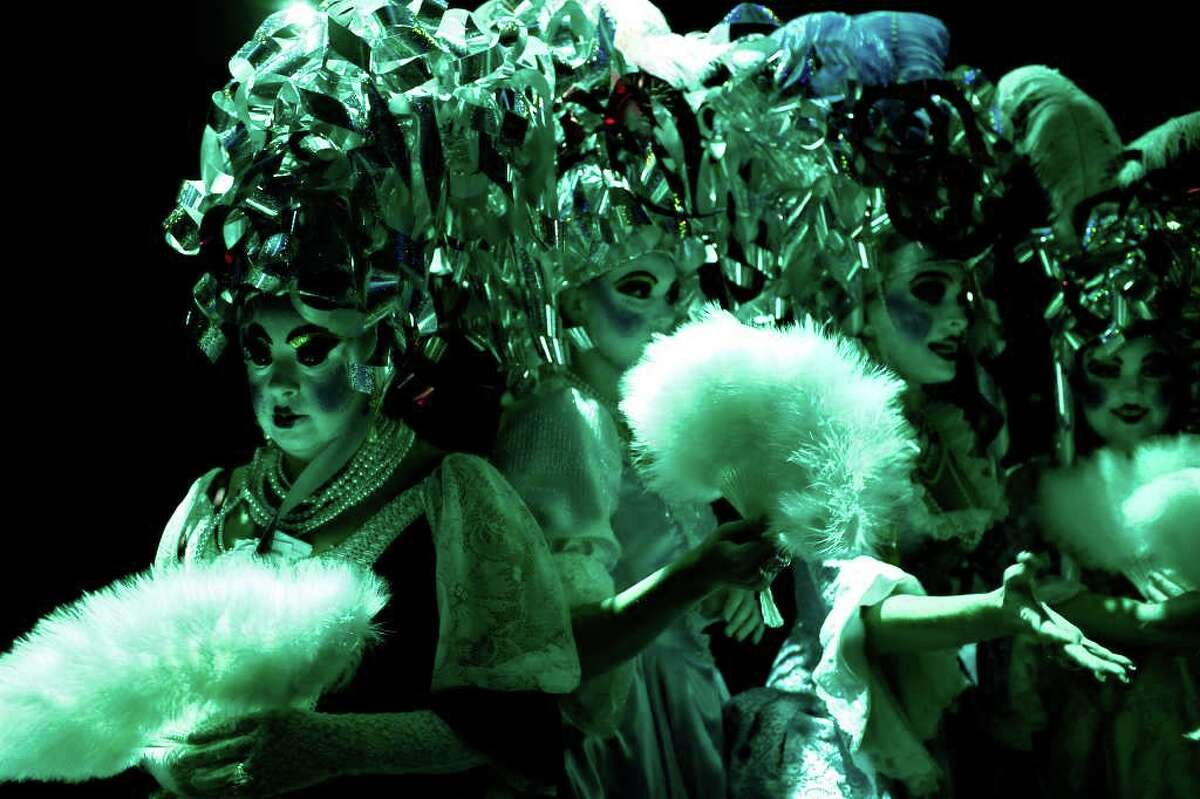 """Terri Upton, left, waits with her fellow """"Consorts To The King"""" to perform the opening scene, The Order of the A-Corn """"Arrival of King Anchovy XLVI,"""" Ruler and Sovereign Head of Cornyation 2011, during Cornyation, The Court of Double-Dip Shellacking, at the Charline McCombs Empire Theatre on Tuesday, April 12, 2011."""