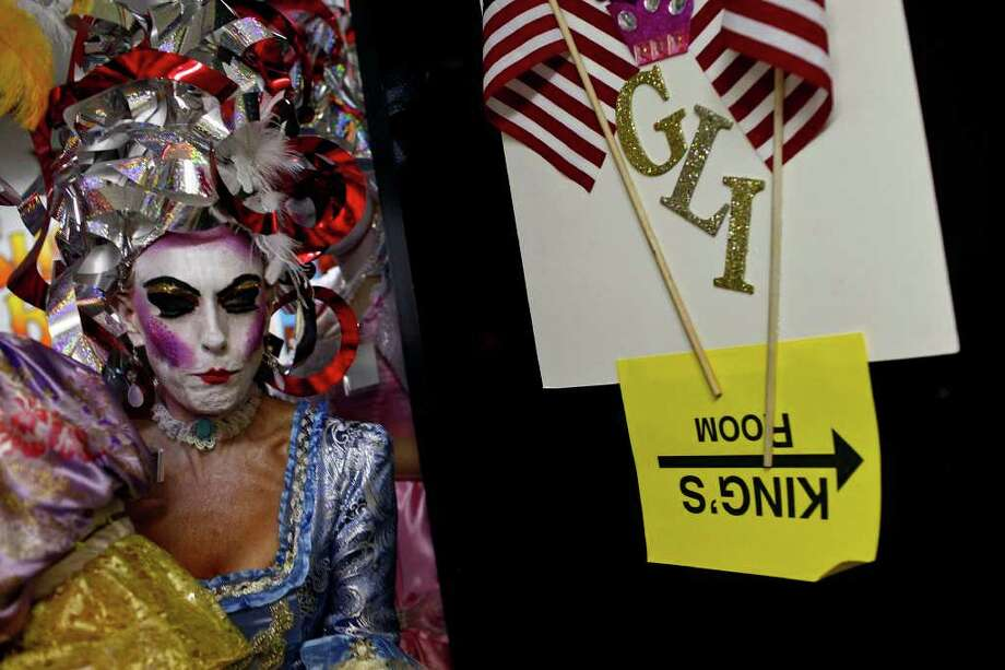 "Jana Baker, one of the ""Consorts To The King"" goes back to the dressing room after performing The Order of the A-Corn ""Arrival of King Anchovy XLVI,"" Ruler and Sovereign Head of Cornyation 2011, waits to perform on opening night of Cornyation, The Court of Double-Dip Shellacking, at the Charline McCombs Empire Theatre on Tuesday, April 12, 2011. Photo: LISA KRANTZ, Lisa Krantz/Express-News / SAN ANTONIO EXPRESS-NEWS"