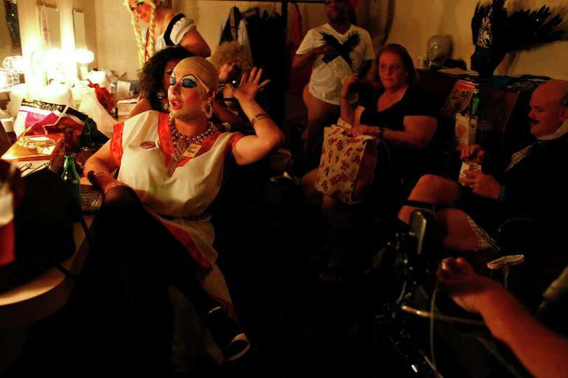 Kareem El Dahab, left, playing Propecia from Rogania, waits in the dressing room with the cast of