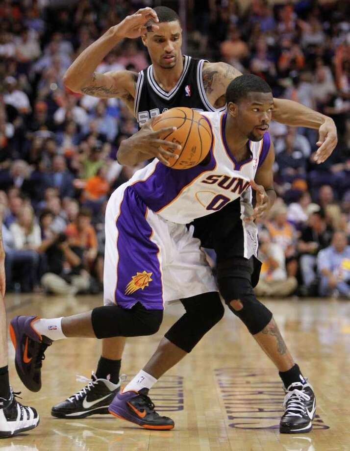 Phoenix Suns' Aaron Brooks (0) drives against San Antonio Spurs' George Hill during the fourth quarter of an NBA basketball game Wednesday, April 13, 2011, in Phoenix. Photo: AP