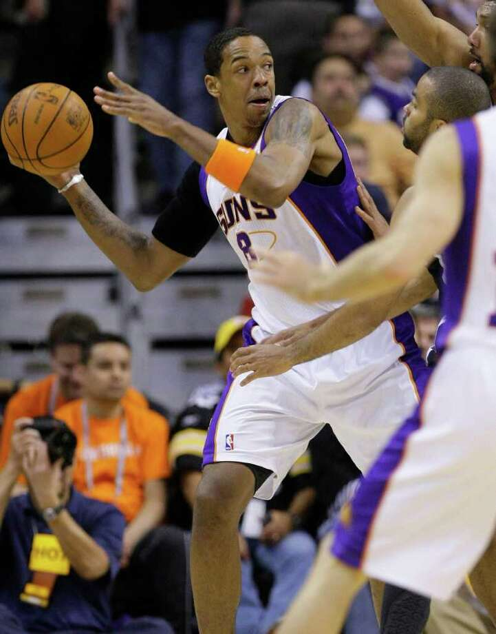 Phoenix Suns' Channing Frye looks to pass against the San Antonio Spurs' during the first  quarter of an NBA basketball game Wednesday, April 13, 2011, in Phoenix. Photo: AP
