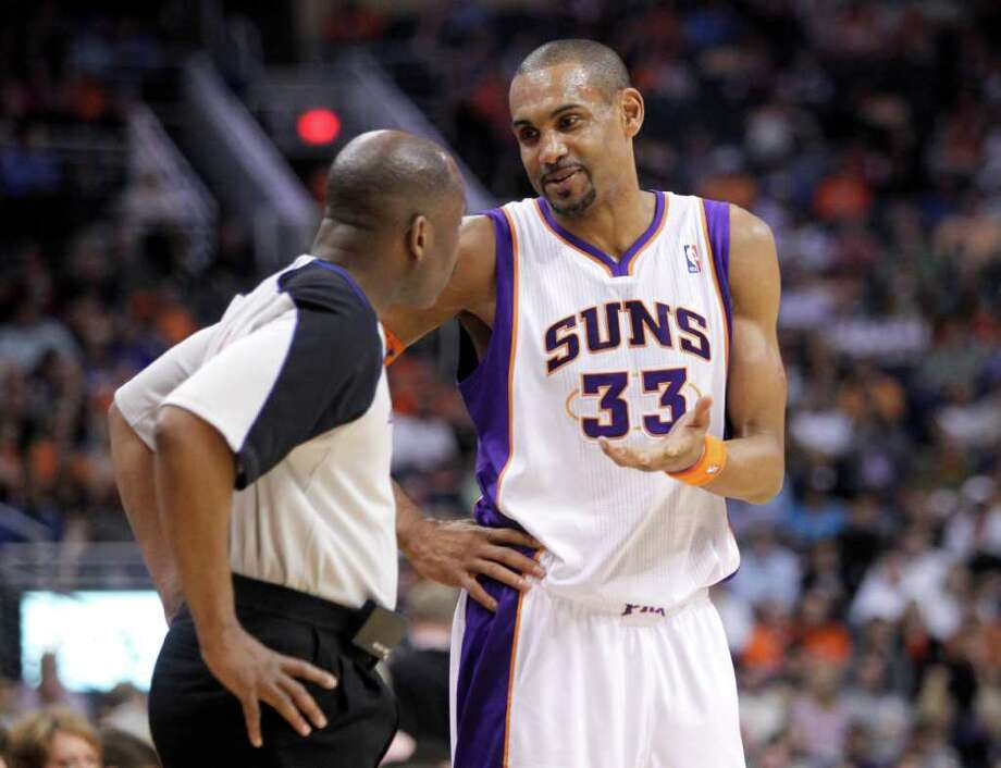 Phoenix Suns' Grant Hill talks with referee Derek Richardson during the first quarter of an NBA basketball game against the San Antonio Spurs on Wednesday, April 13, 2011, in Phoenix. Photo: AP