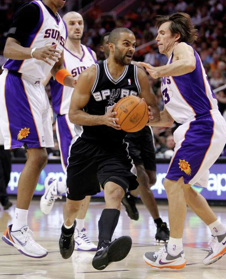 San Antonio Spurs' Tony Parker, of France, drives past Phoenix Suns' Steve Nash, right, during the first quarter of an NBA basketball game Wednesday, April 13, 2011, in Phoenix. Photo: AP