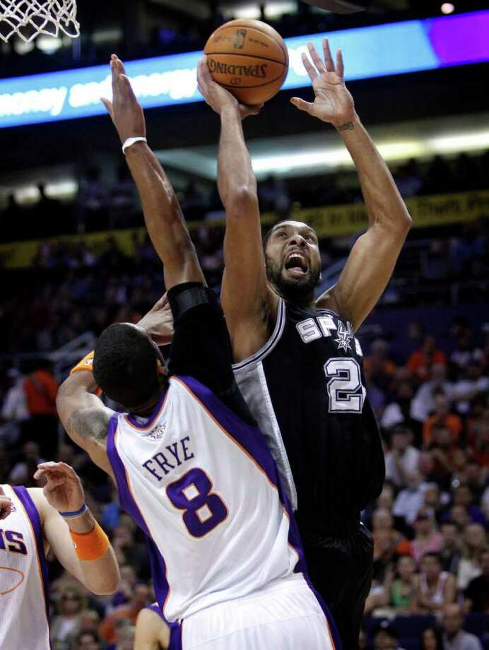 San Antonio Spurs' Tim Duncan shoots over Phoenix Suns' Channing Frye (8) during the first quarter of an NBA basketball game Wednesday, April 13, 2011, in Phoenix. Photo: AP