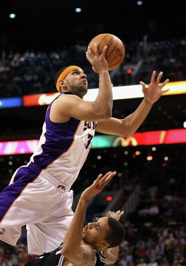 PHOENIX, AZ - APRIL 13:  Jared Dudley #3 of the Phoenix Suns puts up a shot against the San Antonio Spurs during the NBA game at US Airways Center on April 13, 2011 in Phoenix, Arizona.  NOTE TO USER: User expressly acknowledges and agrees that, by downloading and or using this photograph, User is consenting to the terms and conditions of the Getty Images License Agreement.  (Photo by Christian Petersen/Getty Images) *** Local Caption *** Jared Dudley Photo: Christian Petersen, Getty Images / 2011 Getty Images