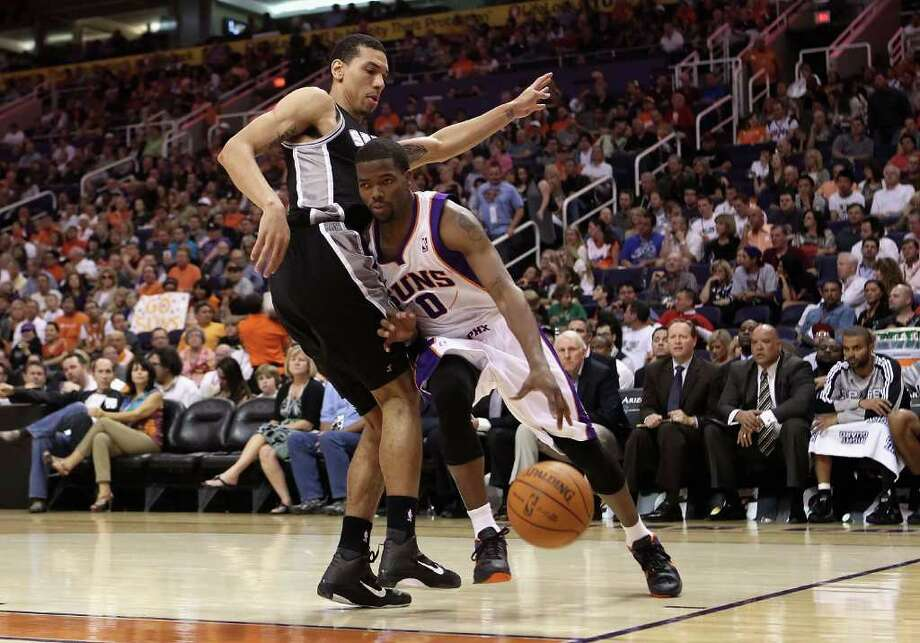 PHOENIX, AZ - APRIL 13:  Aaron Brooks #0 of the Phoenix Suns drives the ball against George Hill #4 of the San Antonio Spurs during the NBA game at US Airways Center on April 13, 2011 in Phoenix, Arizona.  NOTE TO USER: User expressly acknowledges and agrees that, by downloading and or using this photograph, User is consenting to the terms and conditions of the Getty Images License Agreement.  (Photo by Christian Petersen/Getty Images) *** Local Caption *** Aaron Brooks;George Hill Photo: Christian Petersen, Getty Images / 2011 Getty Images