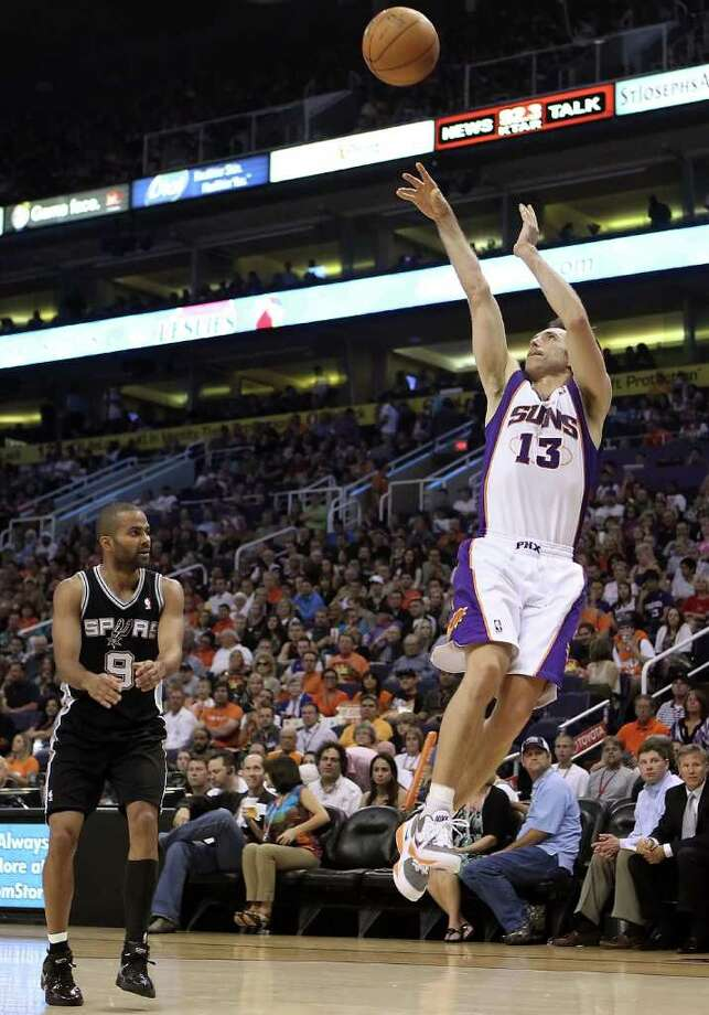 PHOENIX, AZ - APRIL 13:  Steve Nash #13 of the Phoenix Suns puts up a shot against the San Antonio Spurs during the NBA game at US Airways Center on April 13, 2011 in Phoenix, Arizona.  NOTE TO USER: User expressly acknowledges and agrees that, by downloading and or using this photograph, User is consenting to the terms and conditions of the Getty Images License Agreement.  (Photo by Christian Petersen/Getty Images) *** Local Caption *** Steve Nash Photo: Christian Petersen, Getty Images / 2011 Getty Images