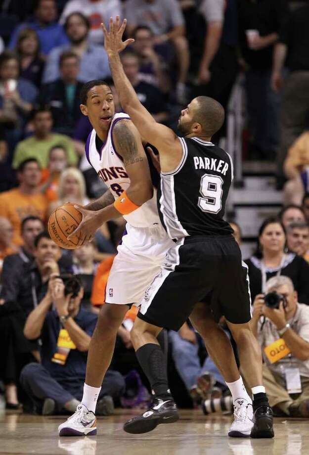 PHOENIX, AZ - APRIL 13:  Channing Frye #8 of the Phoenix Suns looks to pass under pressure from Tony Parker #9 of the San Antonio Spurs during the NBA game at US Airways Center on April 13, 2011 in Phoenix, Arizona.  NOTE TO USER: User expressly acknowledges and agrees that, by downloading and or using this photograph, User is consenting to the terms and conditions of the Getty Images License Agreement.  (Photo by Christian Petersen/Getty Images) *** Local Caption *** Channing Frye;Tony Parker Photo: Christian Petersen, Getty Images / 2011 Getty Images