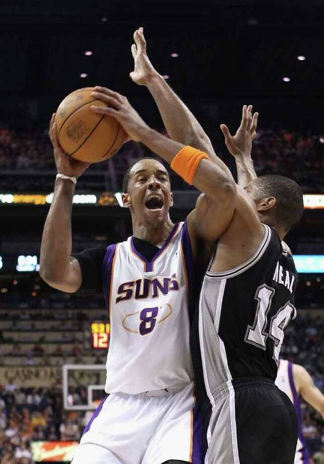 PHOENIX, AZ - APRIL 13:  Channing Frye #8 of the Phoenix Suns handles the ball under pressure from Gary Neal #14 of the San Antonio Spurs during the NBA game at US Airways Center on April 13, 2011 in Phoenix, Arizona.  NOTE TO USER: User expressly acknowledges and agrees that, by downloading and or using this photograph, User is consenting to the terms and conditions of the Getty Images License Agreement.  (Photo by Christian Petersen/Getty Images) *** Local Caption *** Channing Frye;Gary Neal Photo: Christian Petersen, Getty Images / 2011 Getty Images