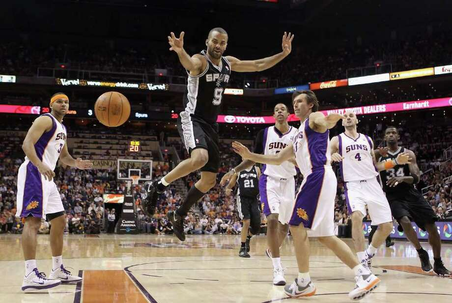 PHOENIX, AZ - APRIL 13:  Tony Parker #9 of the San Antonio Spurs looses the ball as he drives to the net past Steve Nash #13 of the Phoenix Suns during the NBA game at US Airways Center on April 13, 2011 in Phoenix, Arizona.  NOTE TO USER: User expressly acknowledges and agrees that, by downloading and or using this photograph, User is consenting to the terms and conditions of the Getty Images License Agreement.  (Photo by Christian Petersen/Getty Images) *** Local Caption *** Tony Parker;Steve Nash Photo: Christian Petersen, Getty Images / 2011 Getty Images