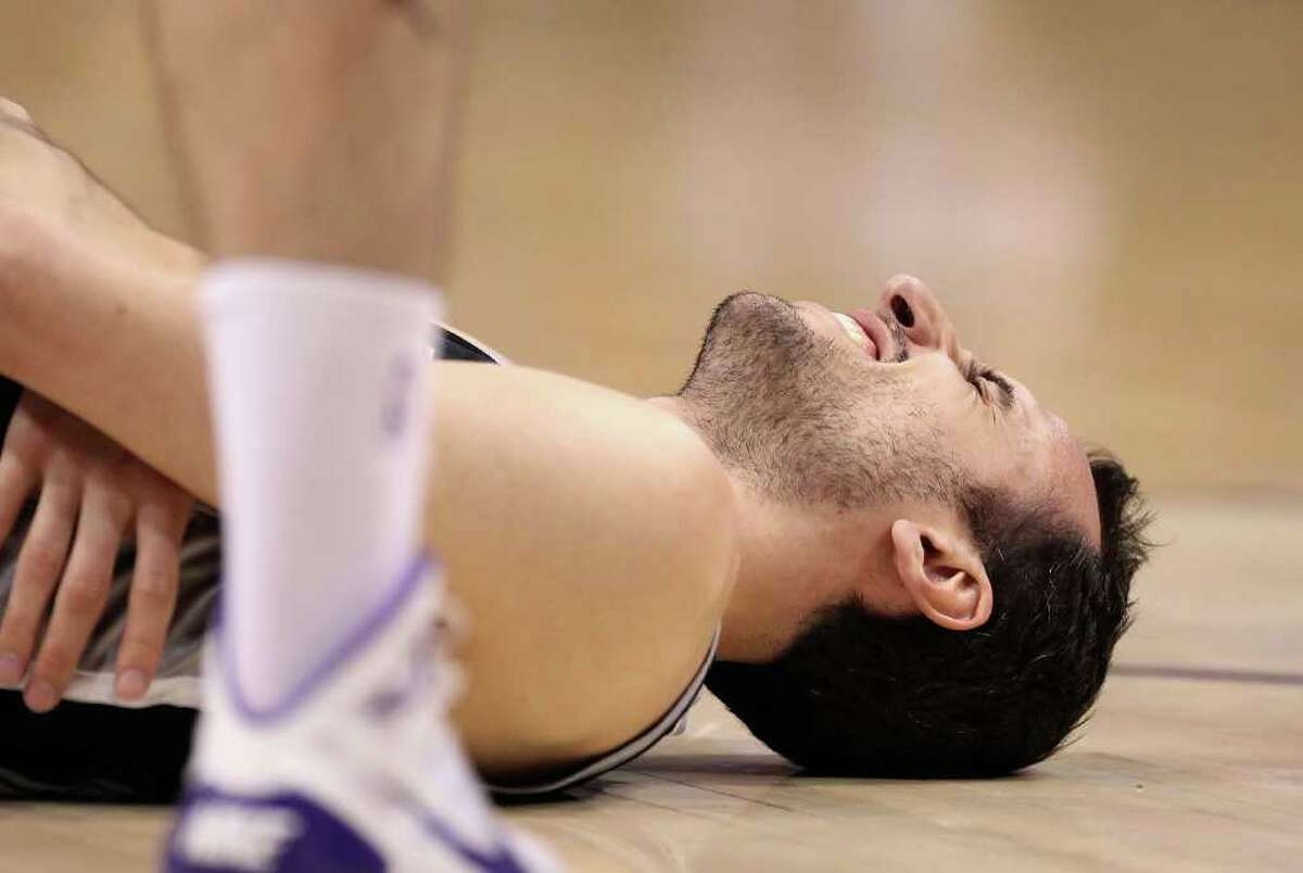PHOENIX, AZ - APRIL 13: Manu Ginobili #20 of the San Antonio Spurs reacts after an injury in the NBA game against the Phoenix Suns at US Airways Center on April 13, 2011 in Phoenix, Arizona. NOTE TO USER: User expressly acknowledges and agrees that, by downloading and or using this photograph, User is consenting to the terms and conditions of the Getty Images License Agreement. (Photo by Christian Petersen/Getty Images) *** Local Caption *** Manu Ginobili