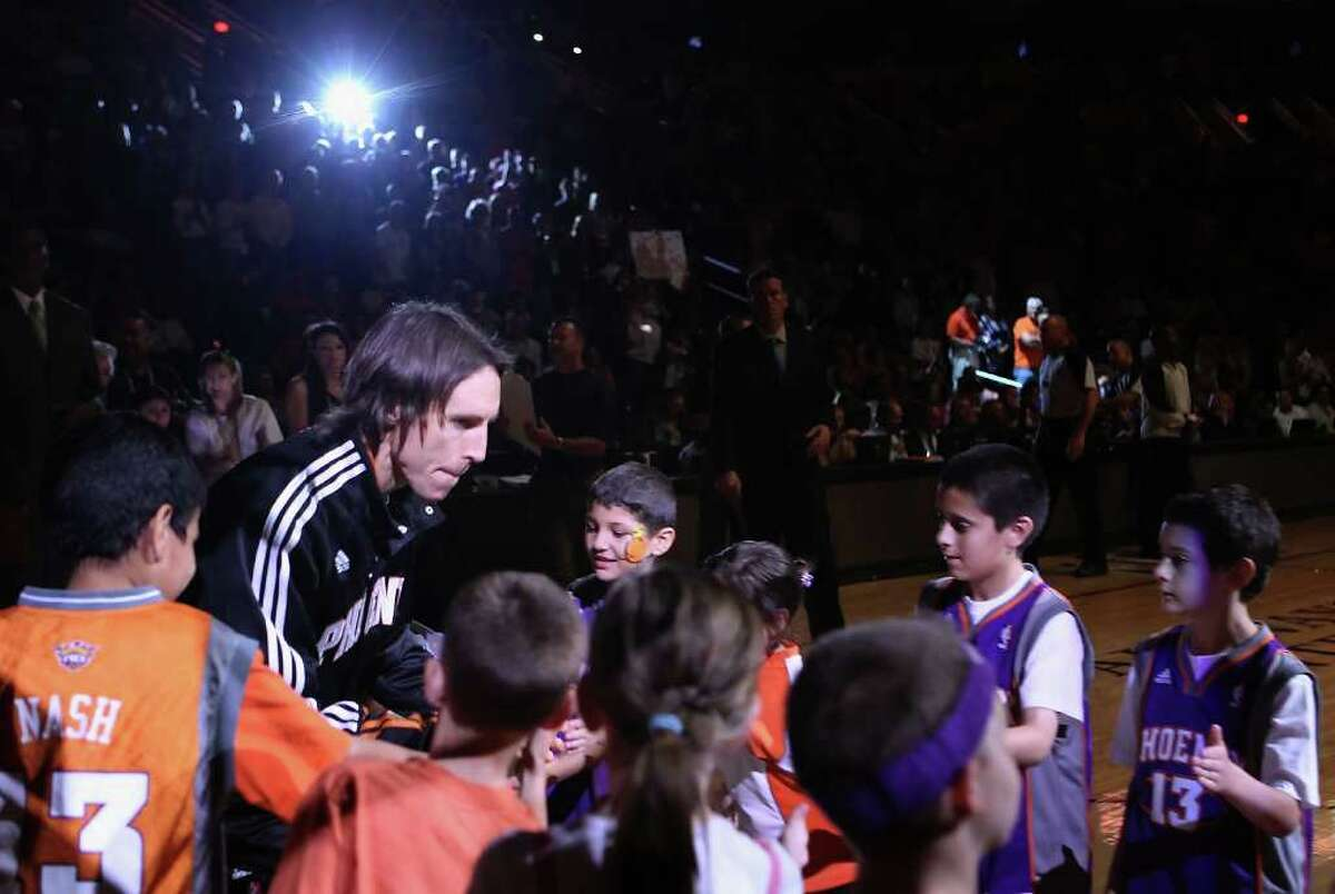 PHOENIX, AZ - APRIL 13: Steve Nash #13 of the Phoenix Suns is introduced before the NBA game against the San Antonio Spurs at US Airways Center on April 13, 2011 in Phoenix, Arizona. NOTE TO USER: User expressly acknowledges and agrees that, by downloading and or using this photograph, User is consenting to the terms and conditions of the Getty Images License Agreement. (Photo by Christian Petersen/Getty Images) *** Local Caption *** Steve Nash