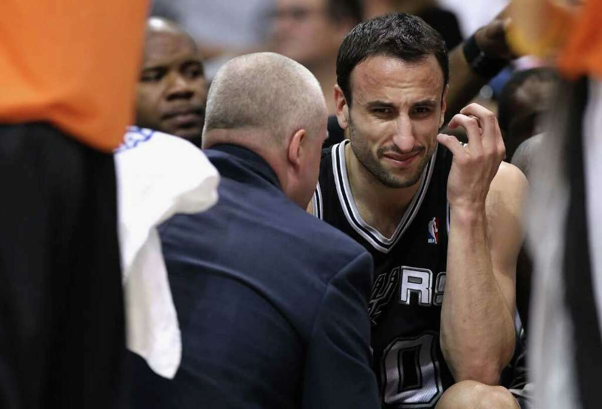 PHOENIX, AZ - APRIL 13: Manu Ginobili #20 of the San Antonio Spurs reacts on the bench after an injury in the NBA game against the Phoenix Suns at US Airways Center on April 13, 2011 in Phoenix, Arizona. NOTE TO USER: User expressly acknowledges and agrees that, by downloading and or using this photograph, User is consenting to the terms and conditions of the Getty Images License Agreement. (Photo by Christian Petersen/Getty Images) *** Local Caption *** Manu Ginobili
