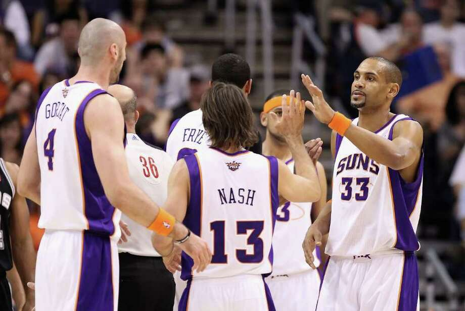 PHOENIX, AZ - APRIL 13:  Grant Hill #33 of the Phoenix Suns high fives teammates Steve Nash #13 and Marcin Gortat #4 after scoring against the San Antonio Spurs during the NBA game at US Airways Center on April 13, 2011 in Phoenix, Arizona.  NOTE TO USER: User expressly acknowledges and agrees that, by downloading and or using this photograph, User is consenting to the terms and conditions of the Getty Images License Agreement.  (Photo by Christian Petersen/Getty Images) *** Local Caption *** Grant Hill;Marcin Gortat;Steve Nash Photo: Christian Petersen, Getty Images / 2011 Getty Images