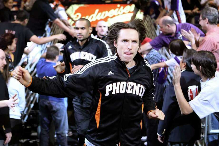 PHOENIX, AZ - APRIL 13:  Steve Nash #13 of the Phoenix Suns runs out onto the court for warm ups to the NBA game against the San Antonio Spurs at US Airways Center on April 13, 2011 in Phoenix, Arizona.  NOTE TO USER: User expressly acknowledges and agrees that, by downloading and or using this photograph, User is consenting to the terms and conditions of the Getty Images License Agreement.  (Photo by Christian Petersen/Getty Images) *** Local Caption *** Steve Nash Photo: Christian Petersen, Getty Images / 2011 Getty Images