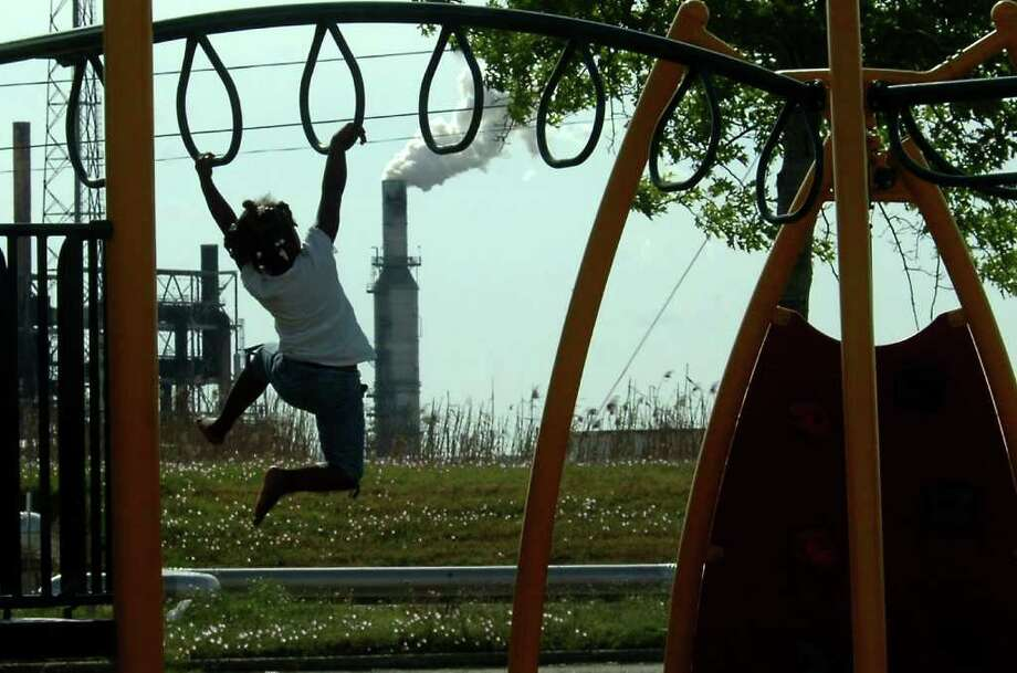 Zykeria Washington plays on the playground on West 15th in Port Arthur, Wednesday. Some residents would like to see sirens installed in West Port Arthur to warn citizens of industrial accidents. Tammy McKinley/The Enterprise Photo: TAMMY MCKINLEY / Beaumont