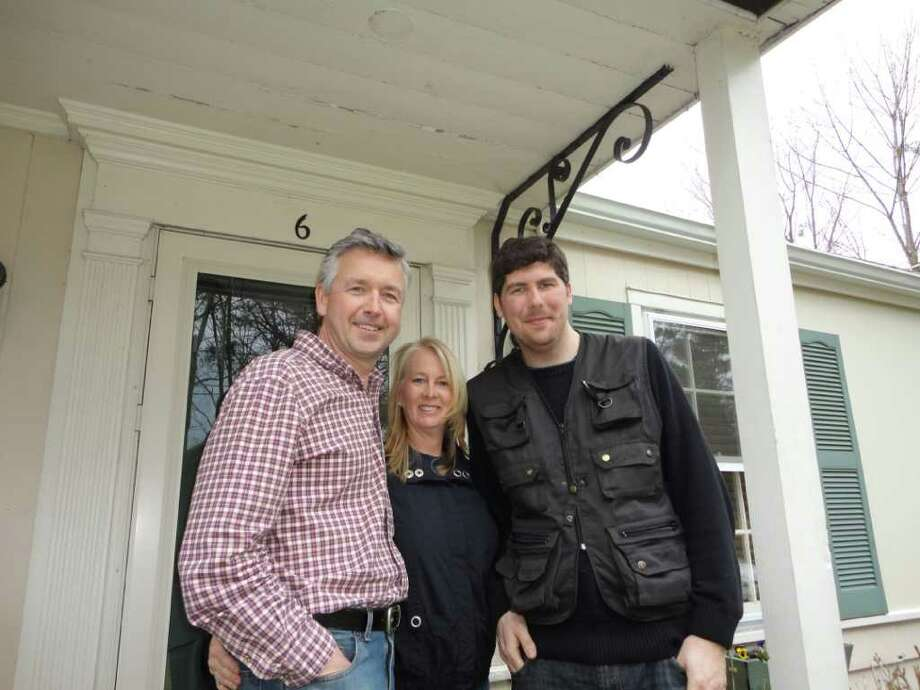 """Filmmaker Jonathan Bucari stands with Chris and Sharon Peterson on the front porch of their Westport home on Westfair Drive home Tuesday during a break in the filming of a television pilot, """"The Sacrificial Lamb,"""" an FBI drama. Photo: Meg Barone / Westport News freelance"""