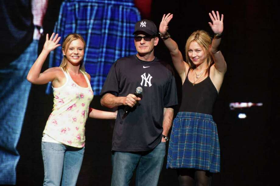 """Charlie Sheen appears onstage with his """"Goddesses"""" Natalie Kenley, right, and Rachel Oberlin at his """"Violent Torpedo of Truth"""" show at Radio City Music Hall in New York, Friday, April 8, 2011. Photo: AP"""