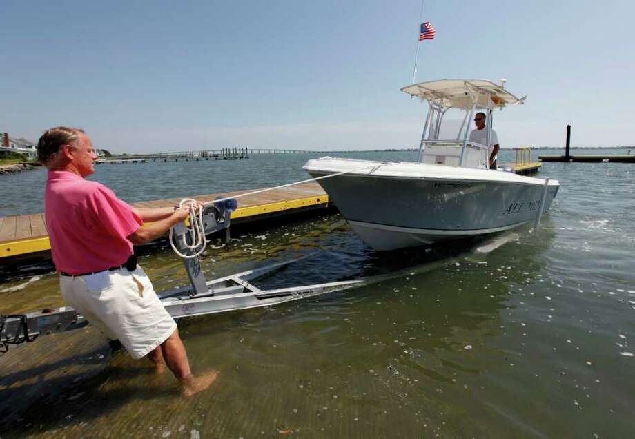 Launching and loading a boat can be a quick, easy task, taking no more than a couple of minutes if boaters follow basic rules and tips. Churck Burton/The Associated Press / AP