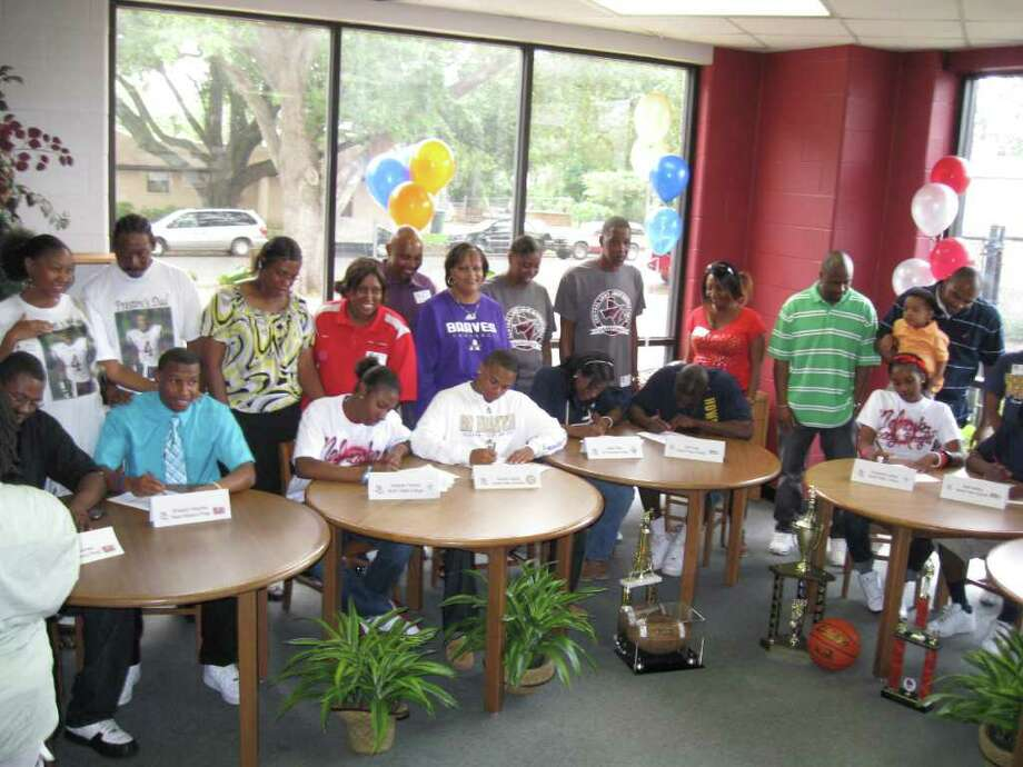 Central football and girls basketball players sign with colleges
