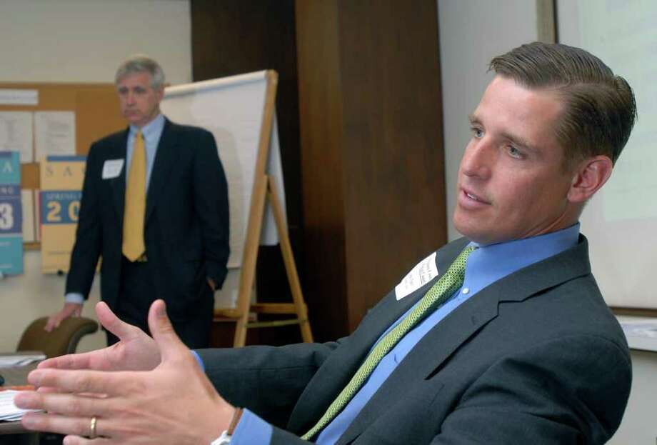 Matthew Fair, right, executive vice president of Norwalk insurance broker Pierson & Smith, address the Business Council of Fairfield County in this file photo. Pierson & Smith on Thursday agreed to be bought by First Niagara of Buffalo, N.Y.  Andrew Sullivan/Staff photo Photo: ST