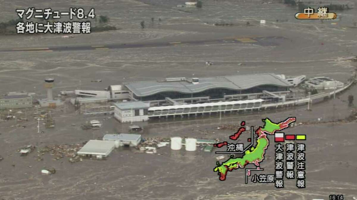 A screen grab taken from news footage by Japanese public broadcaster NHK on March 11, 2011 shows the flooded Sendai Airport. A massive 8.8-magnitude earthquake shook Japan, unleashing a powerful tsunami that sent ships crashing into the shore and carried cars through the streets of coastal towns.