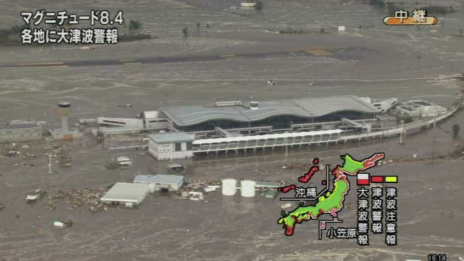 A screen grab taken from news footage by Japanese public broadcaster NHK on March 11, 2011 shows the flooded Sendai Airport.   A massive 8.8-magnitude earthquake shook Japan, unleashing a powerful tsunami that sent ships crashing into the shore and carried cars through the streets of coastal towns. Photo: STR, AFP/Getty Images / 2011 AFP
