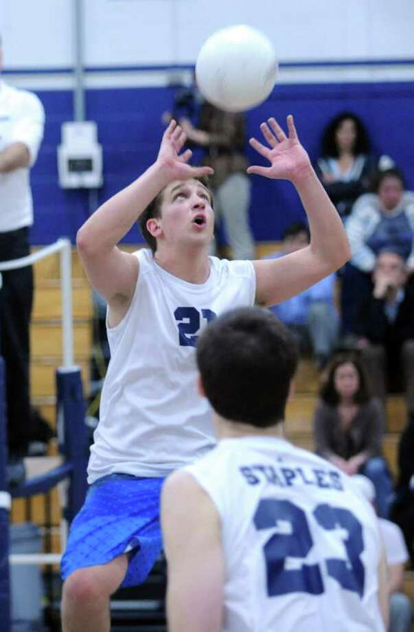 Staples' Daniel Fishman sets up the ball Wednesday, April 13, 2011 during game action against Darien at the school in Westport. Photo: Autumn Driscoll, ST / Connecticut Post