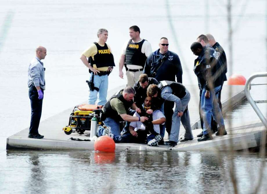 Federal Drug Enforcement Administration agents arrested 44-year-old Raymond Hernandez after he jumped from the Congress Street Bridge and swam to shore. Hernandez led agents on a chase after he allegedly agave an undercover agent $200,000 in exchange for 25 kilos of what he thought was cocaine. (Brian Houle / I.P.A./Special to the Times Union)