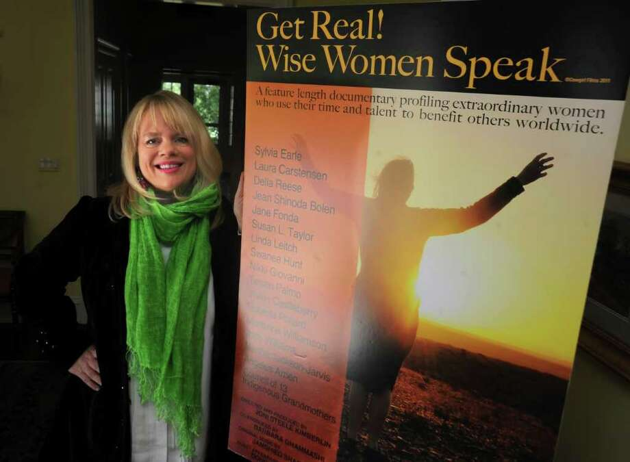 "Greenwich resident Joni Steele Kimberlin, who directed and produced ""Get Real! Wise Women Speak,"" a documentary about older women, stands with a poster for the movie at her home on Thursday, April 14, 2011. Photo: Helen Neafsey / Greenwich Time"