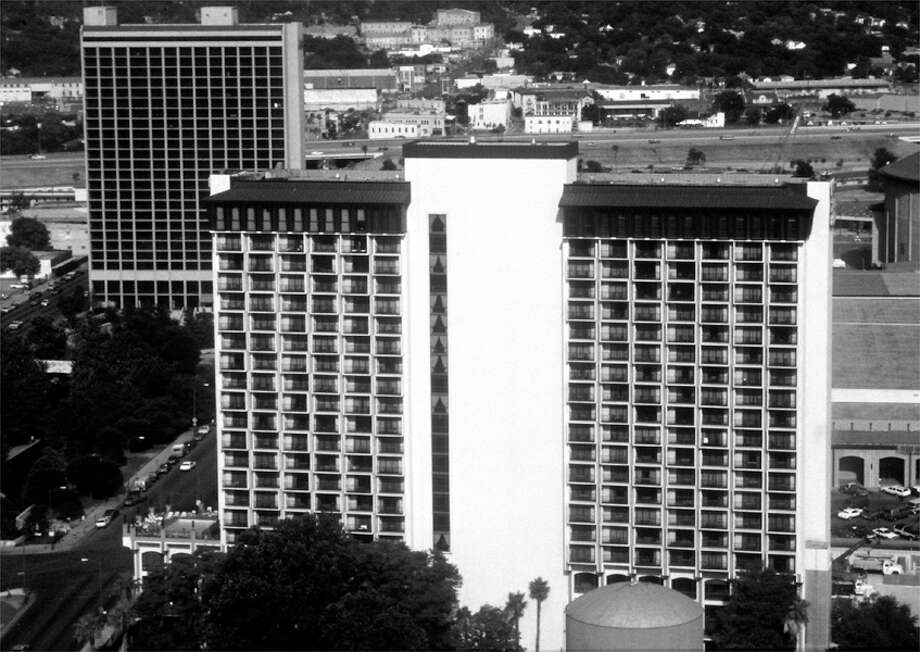 FOCUS 99 #2 / features / Kris Paledes - This is a 1988 file photo of the Hilton Palacio Del Rio (foreground, center) with the Mariott Hotel in the backgournd.  