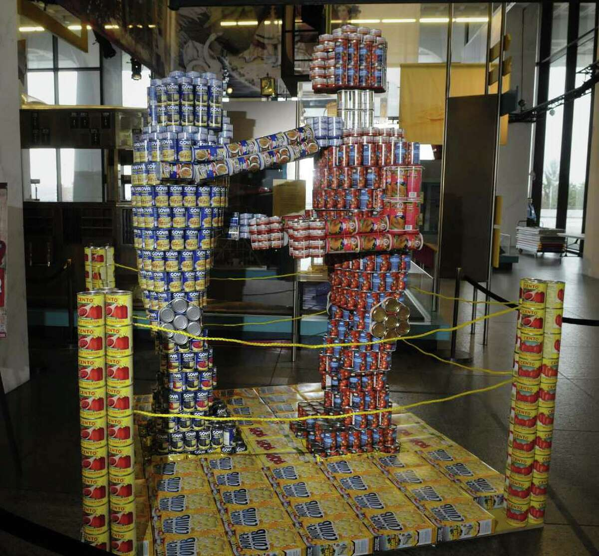 A view of the Rock' Em Sock' Em Canbots sculpture that is part of the Canstruction exhibit in the Terrace Gallery at the New York State Museum on Wednesday morning, April 13, 2011 in Albany. (Paul Buckowski / Times Union)