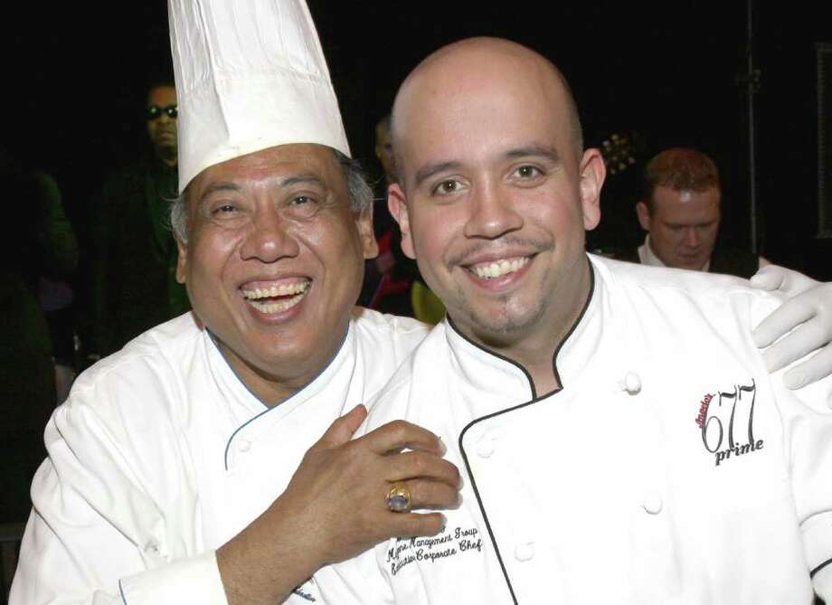 Chefs Yono Purnomo, left, and Jaime Ortiz took part in the ?Top Chef Challenge? during the Gala of Hope, a fundraiser for the American Cancer Society held on Saturday, April 9, at Saratoga Spa State Park in Saratoga Springs, N.Y. (Photo by Joe Putrock / Special to the Times Union) Photo: Joe Putrock / Joe Putrock