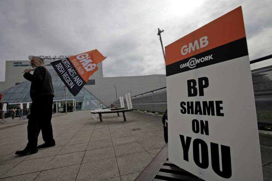 Demonstrators protests against BP outside the conference center where BP held its annual general meeting of its shareholders, in London, Thursday, April 14, 2011. BP's annual shareholder meeting got off to a rowdy start on Thursday as crowds of protesters watched over by police held noisy demonstrations outside the venue. Photo: Lefteris Pitarakis, AP / AP