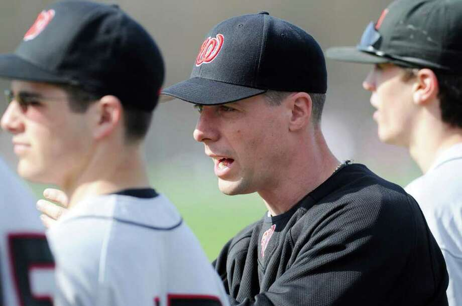 Fairfield Warde baseball coach Mark Caron during high school baseball game between Greenwich High School vs. Fairfield Warde High School, at Greenwich High School,Thursday afternoon, April 14, 2011. Photo: Bob Luckey / Greenwich Time