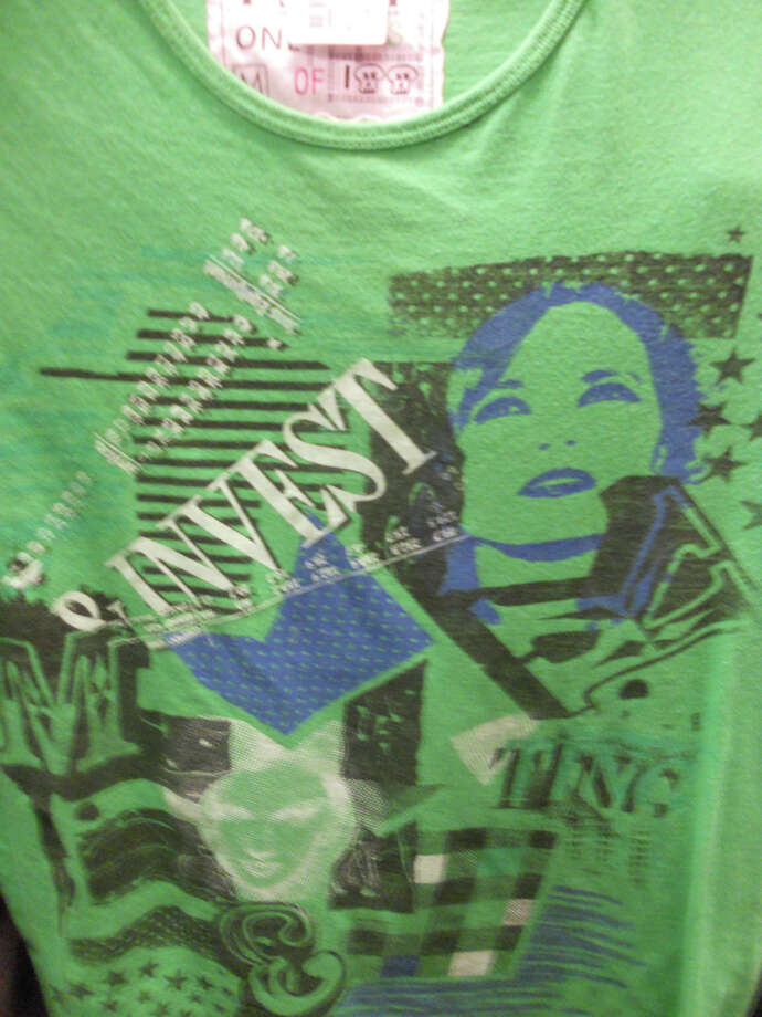 Plato's Closet's men's T-shirt is one of 100 and costs $8. JENNIFER RODRIGUEZ / SPECIAL TO THE EXPRESS-NEWS
