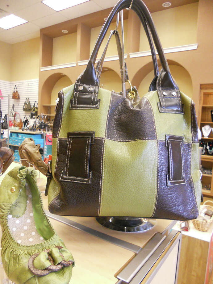 754 NW Loop 410, Suite 100: Shoes 'N Bags green flats, $24.99, and brown-and-green handbag, $39.99, are designed by San Antonio nurse and store owner Razieh.