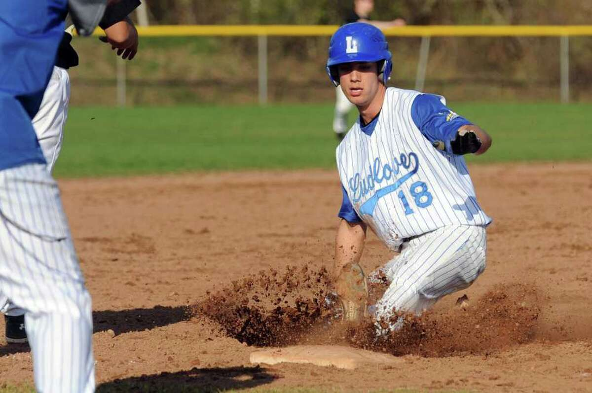Highlights from boys baseball action between Fairfield Ludlowe and Trumbull in Fairfield, Conn. on Thursday April 14, 2011. Ludlowe's #18 James Schanck slides into third.