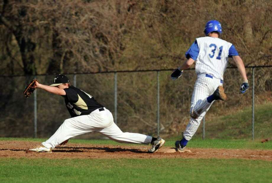 Highlights from boys baseball action between Fairfield Ludlowe and Trumbull in Fairfield, Conn. on Thursday April 14, 2011. Photo: Christian Abraham / Connecticut Post
