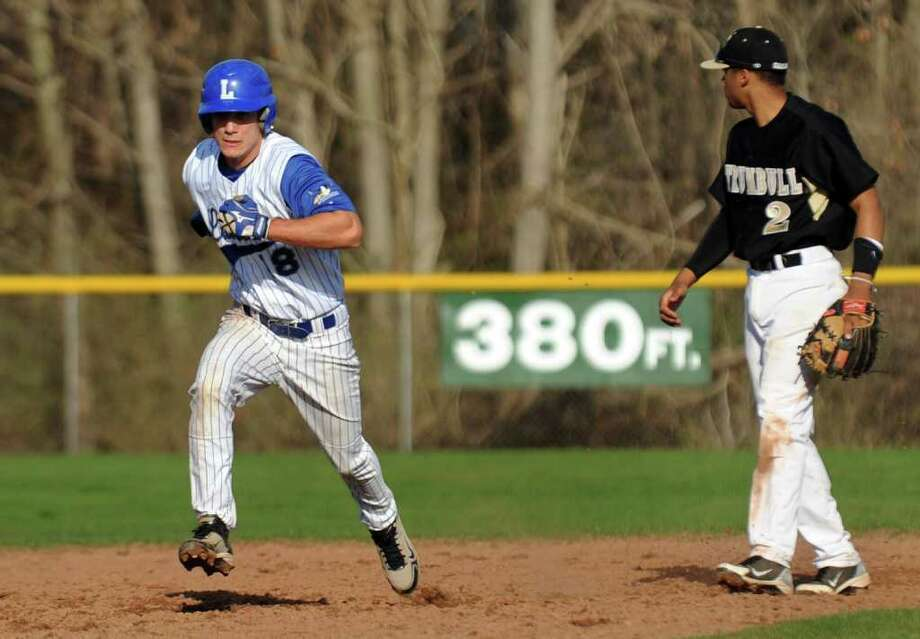 Highlights from boys baseball action between Fairfield Ludlowe and Trumbull in Fairfield, Conn. on Thursday April 14, 2011. Ludlowe's #18 James Schanck rounds second base. Photo: Christian Abraham / Connecticut Post