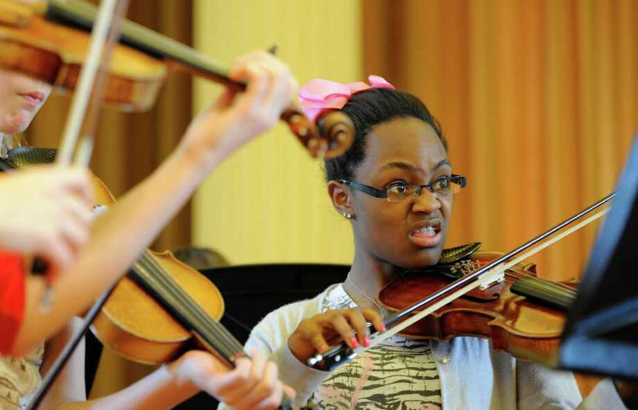 Jamie Curcio grimaces as she plays with the Walden Chamber Players who were visiting artists at the Hacket Middle School in Albany, N.Y. April 14, 2011.    (Skip Dickstein / Times Union) Photo: Skip Dickstein