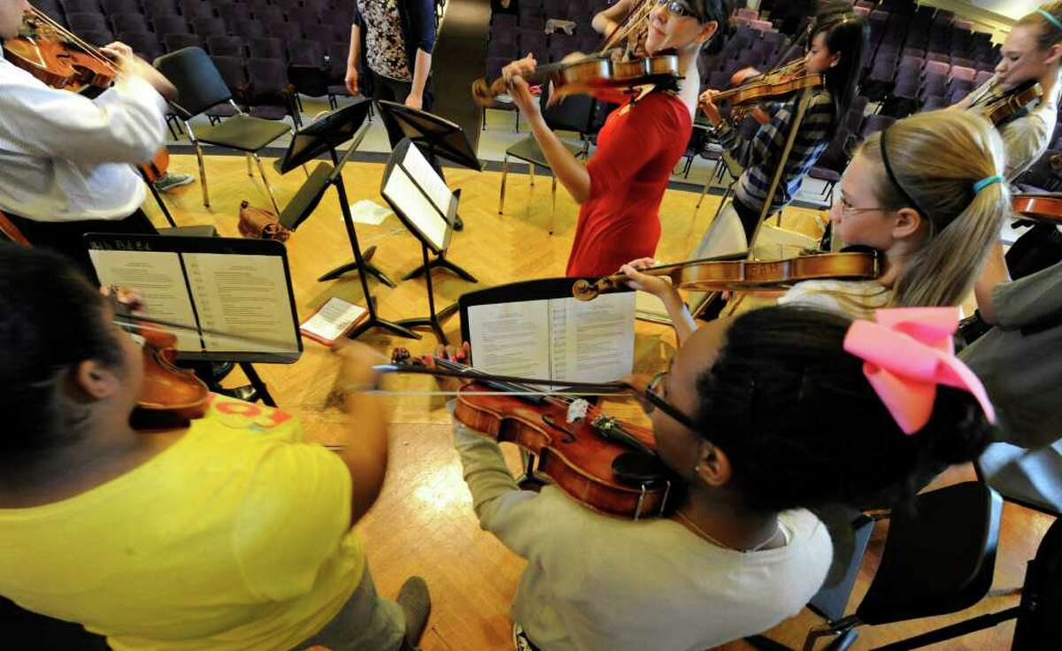 Gabby Diaz, center of The Walden Chamber Players of Arlington, Mass. gives direction during a visit to the Hacket Middle School in Albany, N.Y. April 14, 2011. (Skip Dickstein / Times Union)