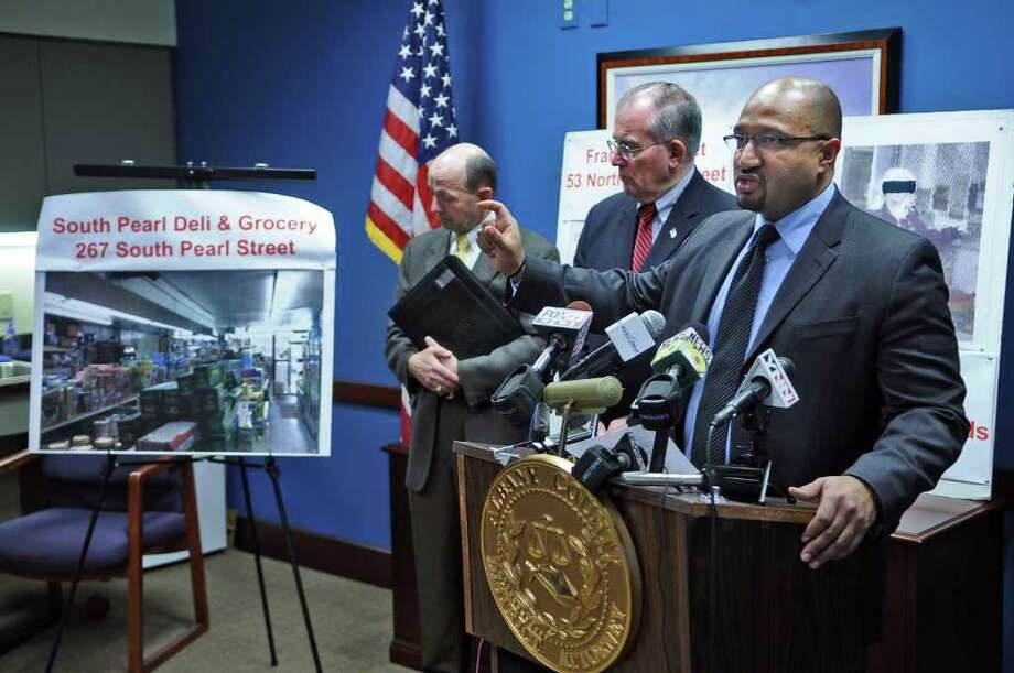 District Attorney P. David Soares announces a multi-million dollar welfare fraud ring busted in Albany County, along with Albany County Department of Social Services Commissioner Vincent Colonno, left, and Albany County Executive Michael Breslin on Thursday April 14, 2011 in Albany, NY. An interior photograph of the South Pearl Deli & Grocery, part of the investigation, is at left. ( Philip Kamrass / Times Union ) Photo: Philip Kamrass