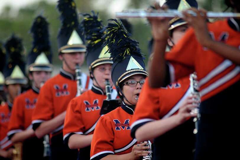 Madison High School Band members march in review during the 73rd Battle of Flowers Band Festival at
