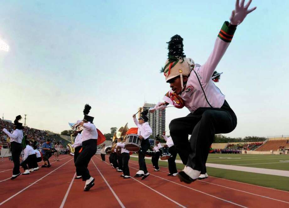 Sam Houston High School drum major Edward Harris and band members dance during the 73rd Battle of Flowers Band Festival at Alamo Stadium on Thursday, April 14, 2011. Photo: BILLY CALZADA, Billy Calzada/Express-News / gcalzada@express-news.net